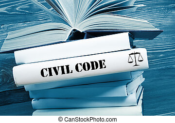 Book with Civil Code word on table in a courtroom or enforcement office. Toned image