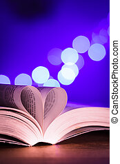 Book with low light and blue bokeh