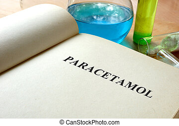 paracetamol - Book with paracetamol and test tubes on a...