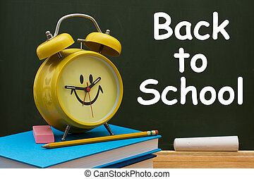Book with pencil and eraser with a retro alarm clock in front of a chalkboard, Back to School Time