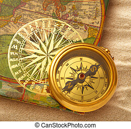 Book with retro golden compass