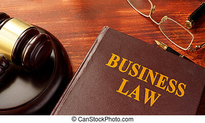 Book with title business law and gavel.