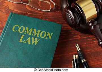 Book with title common law on a table.