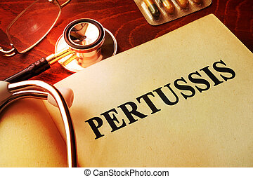 Book with title Pertussis on a table.