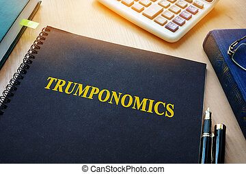 Book with title Trumponomics on an office desk.