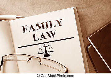 family law - Book with words family law and glasses.