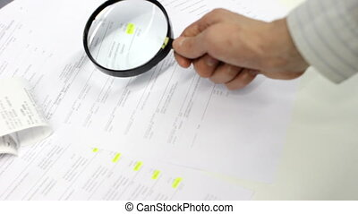 Bookkeeping - Book keeper with magnifying glass and papers.