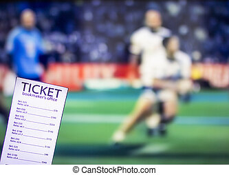 Bookmaker ticket on the background of the TV on which there is a sports game of cricket, sports betting, gambler