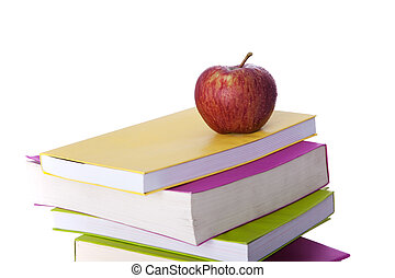 Books and a fresh apple - stack of colorful books and a...