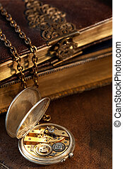 Books and antique pocket watch