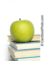 books and apple - Green apple and stack of books for school