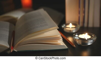 Books and candles camera moving left