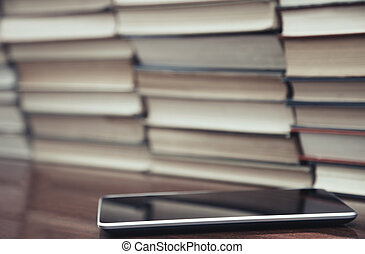 Books and digital tablet - Digital tablet on the table and...