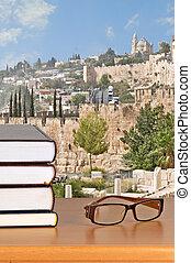 Books and eyeglasses on desk