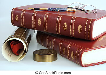 Books and graduation diploma