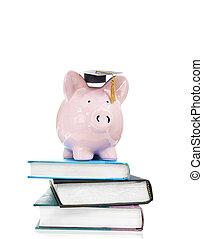 books and graduation piggy bank