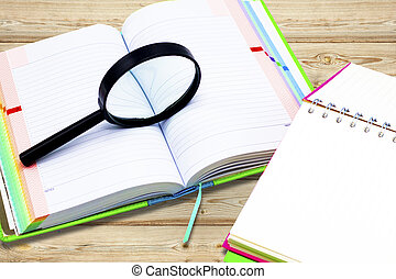 Books and  Magnifying glass on board background, education and back to school concept,Clipping path