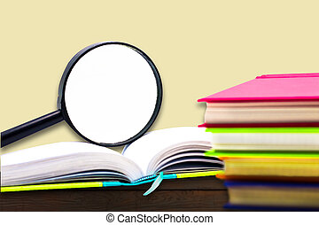 Books and  Magnifying glass on wood background, education and back to school concept,Clipping path