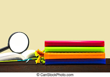 Books and office  Magnifying glass on wood background, education and back to school concept,Clipping path