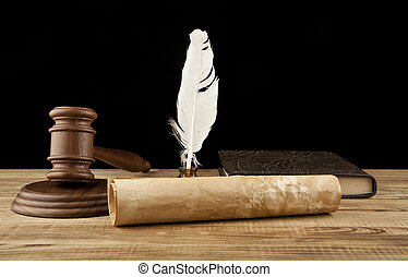 books and wooden gavel on black background