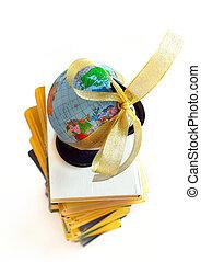 Books and world globe