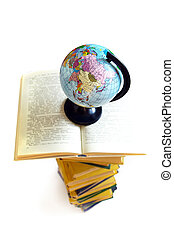 Books and world globe on white