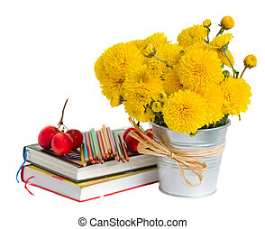 Books and yellow mums flowers