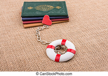 Books attached to a life saver with a chain