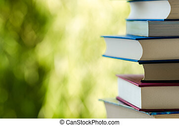 Books against green background