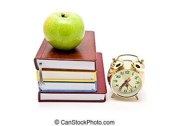 books, clock and apple