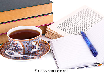 Books, cup of tea and pen