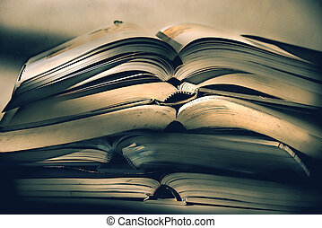 Heap of old books against white background