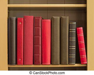 Books in a bookshelf as a background