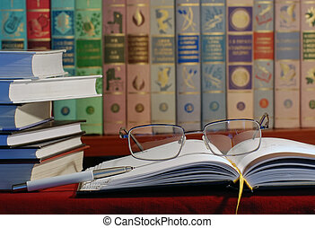 Books in library and glasses