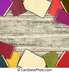 books lie on a dark wooden table