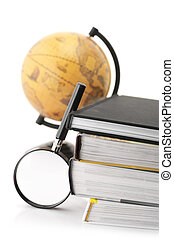 Books, magnifier and globe
