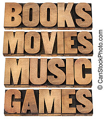 books, movies, music and games - entertainment concept - ...