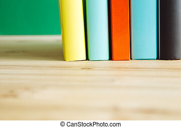 books on a wooden desk