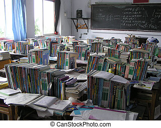 books on the desk in a classroom
