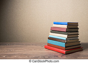 Books on the table. No labels.
