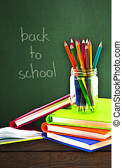 Books ,pen,pencil on green background, education and back to school concept,Clipping path