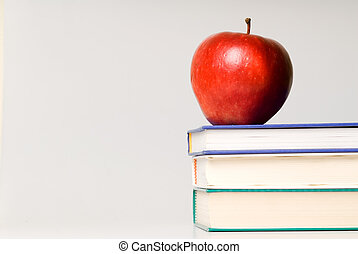 Books - red apple and stack of books for school