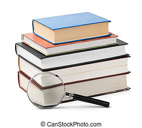 Books review - Magnifying glass and books stack isolated on...