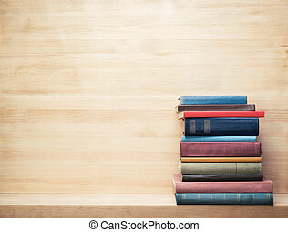 Books - Old books on a wooden shelf.