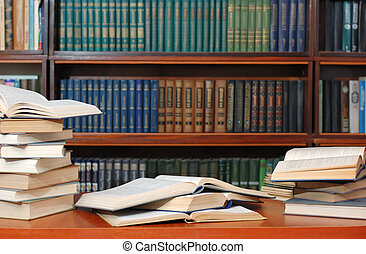Books. Textbooks spread out to a table before examination