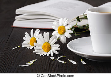 books with bouquet of flowers