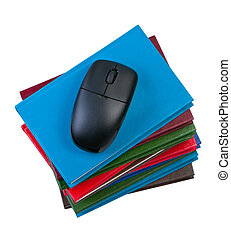 Books with computer mouse isolated on white background.
