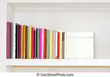 Bookshelf on the wall with colorful books