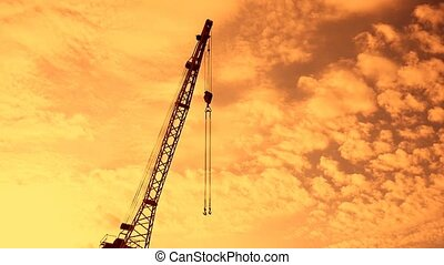 boom crane with hook silhouette at sunset video - boom crane...