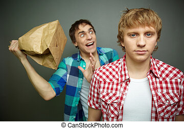 Boom - Crazy guy being ready to explode paper bag behind his...